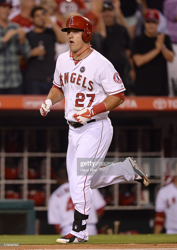 Mike Trout #27 of the Los Angeles Angels reacts to his solo homerun for a 4-0 lead over the Oakland Athletics during the fifth inning at Angel Stadium of Anaheim on July 19, 2013 in Anaheim, California.