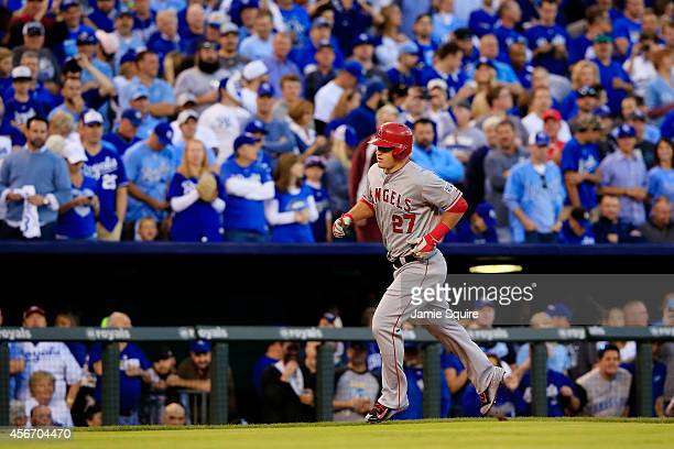 Mike Trout of the Los Angeles Angels rounds the bases after hitting a home run in the first inning against the Kansas City Royals during Game Three...