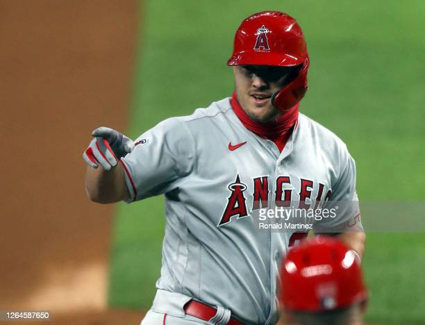 Mike Trout of the Los Angeles Angels runs the bases after hitting a two-run home run in the first inning against the Texas Rangers at Globe Life...