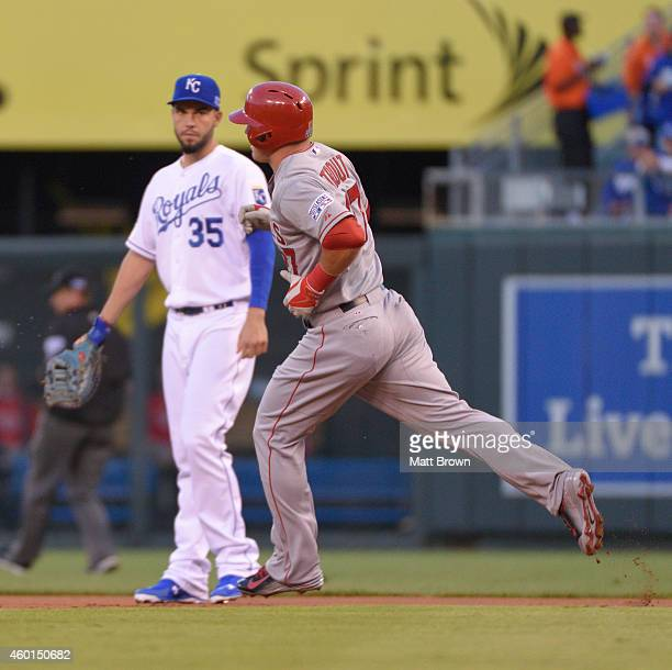 Mike Trout of the Los Angeles Angels runs the bases in front of Eric Hosmer of the Kansas City Royals after hitting a home run during game 3 of the...