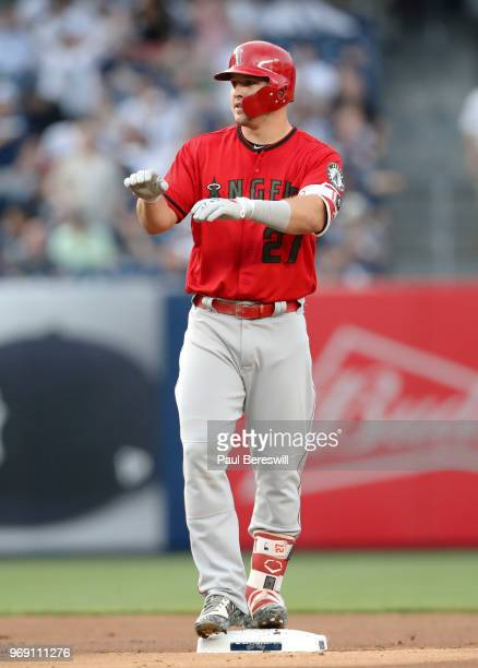 Mike Trout of the Los Angeles Angels signals from second base after hitting an rbi double in the first inning in an MLB baseball game against the New...