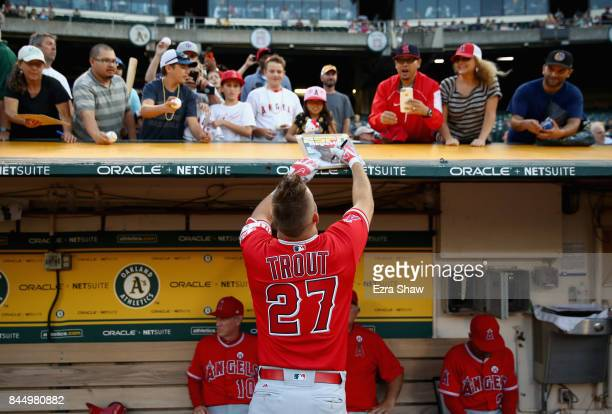 Mike Trout of the Los Angeles Angels signs autographs before their game against the Oakland Athletics at Oakland Alameda Coliseum on September 5 2017...