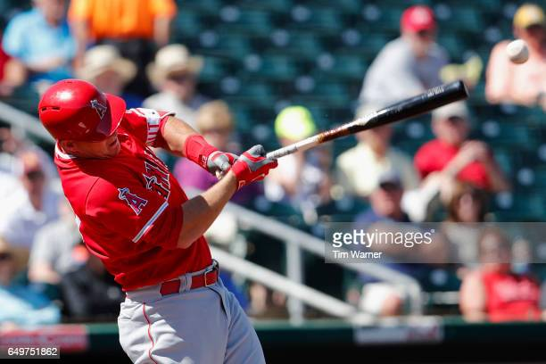 Mike Trout of the Los Angeles Angels singles in the first inning against the Cincinnati Reds during the spring training game at Goodyear Ballpark on...