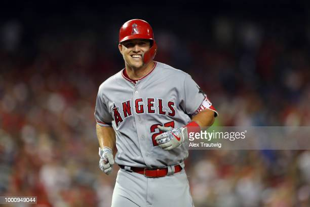 Mike Trout of the Los Angeles Angels smiles as he crosses the plate after hitting a home run in the third inning during the 89th MLB AllStar Game at...