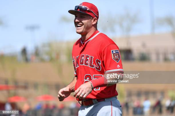Mike Trout of the Los Angeles Angels smiles while warming up for the spring training game against the Arizona Diamondbacks at Salt River Fields at...
