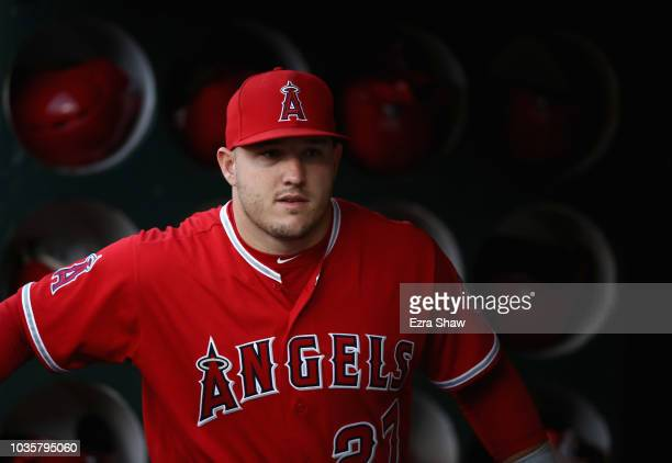 Mike Trout of the Los Angeles Angels stands in the dugout before their game against the Oakland Athletics at Oakland Alameda Coliseum on September 18...