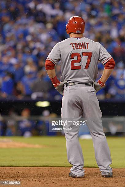 Mike Trout of the Los Angeles Angels stands in the rain during game 3 of the American League Division Series against the Kansas City Royals on...