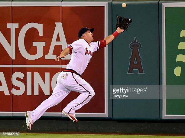 Mike Trout of the Los Angeles Angels stretches to make a catch for an out of Adam Eaton of the Chicago White Sox to end the top of the sixth inning...