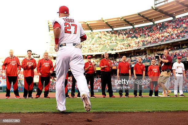 Mike Trout of the Los Angeles Angels takes the field for Game One of the American League Division Series against the Kansas City Royals at Angel...