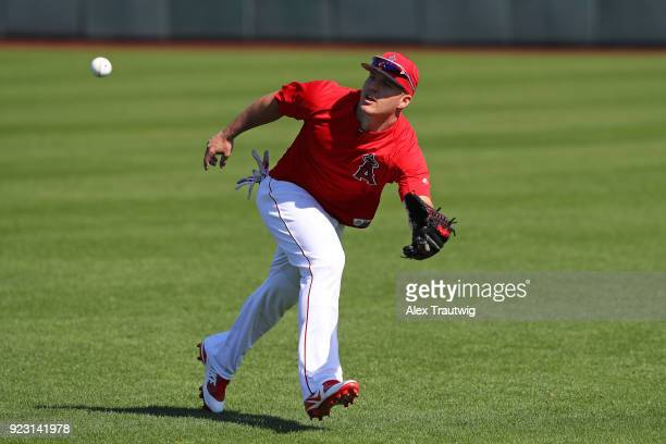 Mike Trout of the Los Angeles Angels tries to make a catch during workouts on Thursday February 22 2018 at Tempe Diablo Stadium in Tempe Arizona