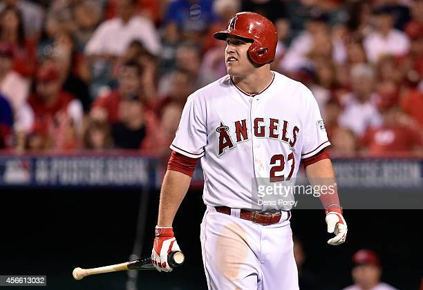 Mike Trout of the Los Angeles Angels walks back to the dugout after grounding out in the fourth inning against the Kansas City Royals during Game Two...
