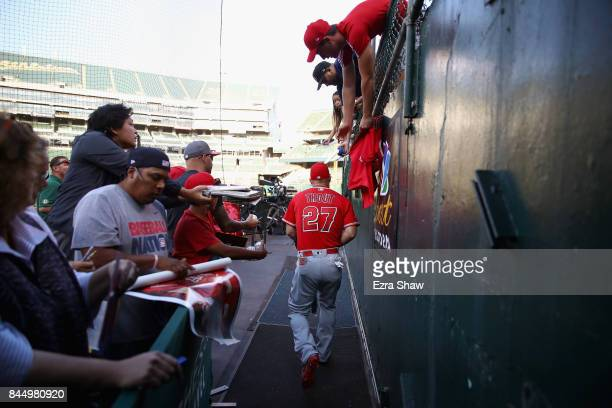 Mike Trout of the Los Angeles Angels walks out to the field for their game against the Oakland Athletics at Oakland Alameda Coliseum on September 5...