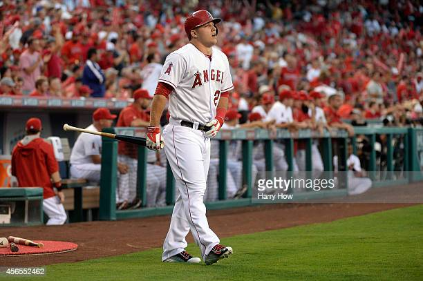 Mike Trout of the Los Angeles Angels walks to the plate in the first inning against the Kansas City Royals during Game One of the American League...
