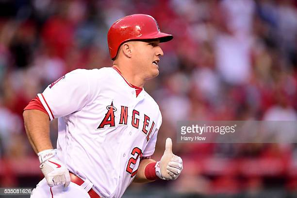 Mike Trout of the Los Angeles Angels watches his solo homerun to tie the score 11 with the Houston Astros during the first inning at Angel Stadium of...