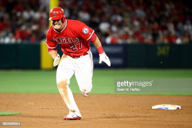 Mike Trout runs back to first base after being hit into a double play on a fly ball hit by Albert Pujols of the Los Angeles Angels of Anaheim during...
