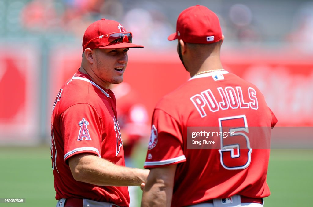 Mike Trout #27 talks with Albert Pujols #5 of the Los Angeles Angels before the game against the Baltimore Orioles at Oriole Park at Camden Yards on July 1, 2018 in Baltimore, Maryland.