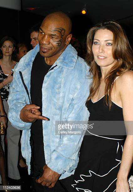 Mike Tyson and Alixe Boyer during Dior Sponsors the Solomon R Guggenheim Museum's Young Collectors Council Artist's Ball Honoring Matthew Ritchie at...