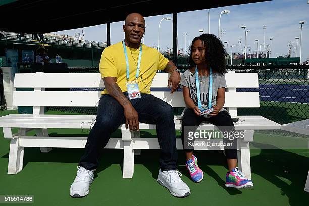 Mike Tyson and daughter Milan Tyson sit on the practice courts during day seven of the BNP Paribas Open at Indian Wells Tennis Garden on March 13...