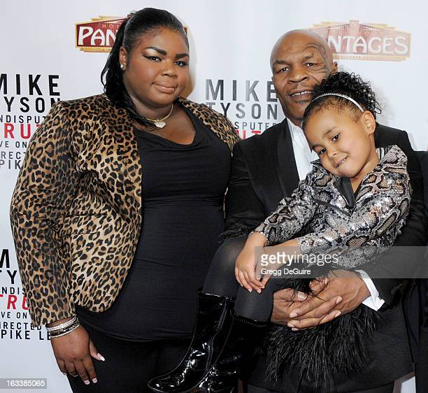 Mike Tyson and daughters Mikey Tyson and Milan Tyson arrive at the Los Angeles opening night of Mike Tyson Undisputed Truth at the Pantages Theatre...