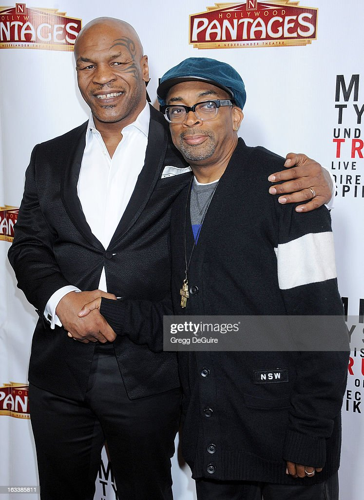 Mike Tyson and director Spike Lee arrive at the Los Angeles opening night of 'Mike Tyson - Undisputed Truth' at the Pantages Theatre on March 8, 2013 in Hollywood, California.