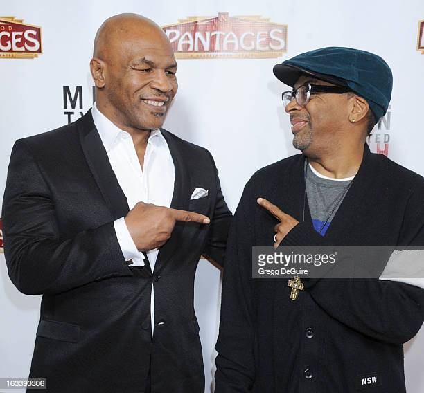 Mike Tyson and director Spike Lee arrive at the Los Angeles opening night of Mike Tyson Undisputed Truth at the Pantages Theatre on March 8 2013 in...