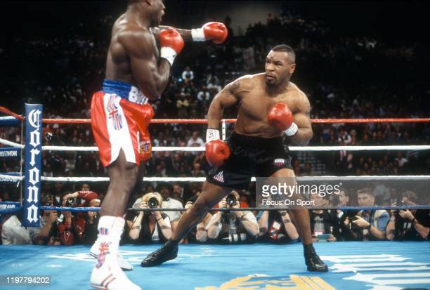 Mike Tyson and Frank Bruno fights for WBC Heavyweight title on March 16, 1996 at the MGM Grand Garden Arena in Las Vegas, Nevada. Tyson won the fight...