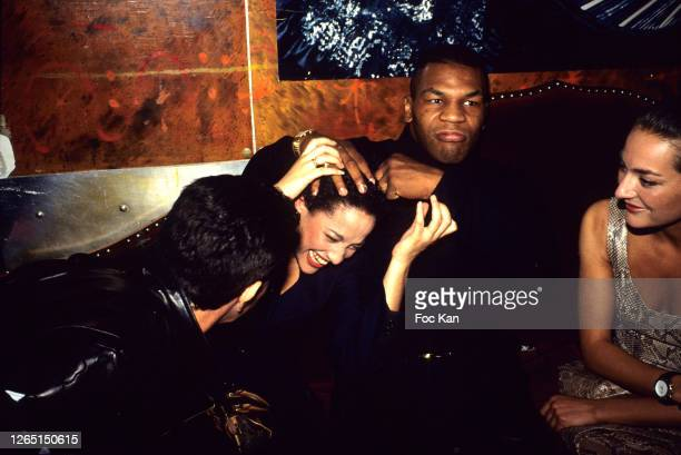 Mike Tyson and his guest attend a Fashion week Party at Les Bains Douches during A Paris Fashion Weeks in the 1990s in Paris France