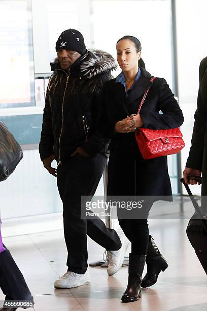 Mike Tyson and his wife Lakiha Spicer are seen at Paris Charles de Gaulle Airport departure terminal on December 12, 2013 in Paris, France. Mike...