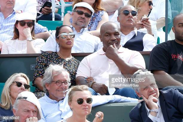Mike Tyson and his wife Lakiha Spicer attend the 2018 French Open Day Twelve at Roland Garros on June 7 2018 in Paris France