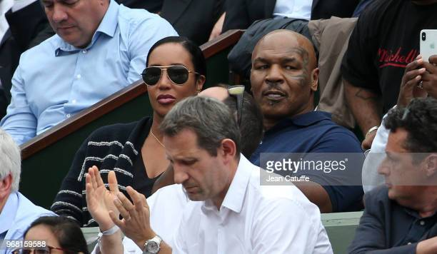 Mike Tyson and his wife Lakiha Spicer attends Sloane Stephens of USA victory during Day 10 of the 2018 French Open at Roland Garros stadium on June 4...