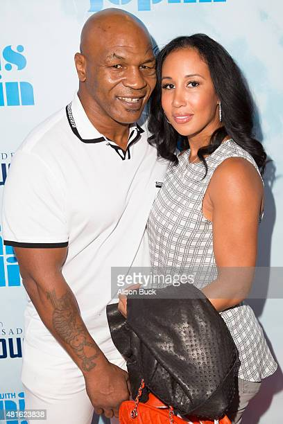 Mike Tyson and Lakiha Spicer attend A Night With Janis Joplin Los Angeles Opening Night Performance at Pasadena Playhouse on July 22 2015 in Pasadena...
