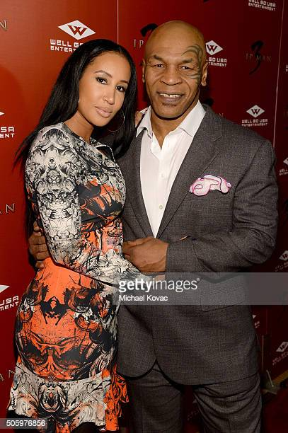 """Mike Tyson and Lakiha Spicer attend the Los Angeles Premiere of Well Go USA Entertainment's """"IP MAN 3"""" at The Grove on January 20, 2016 in Los..."""