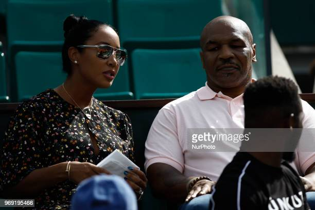 Mike Tyson and Lakiha Spicer attend the tennis match game during the Roland Garros Tournament in Paris France on June 7 2018