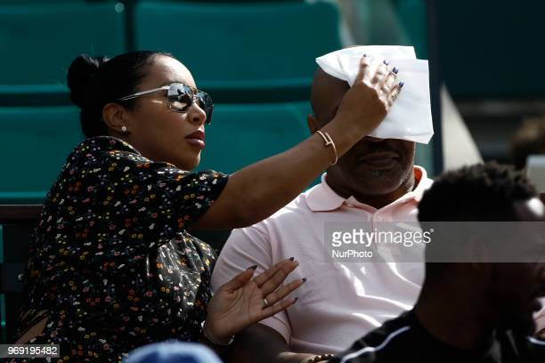 Mike Tyson and Lakiha Spicer attend the tennis match game during the Roland Garros Tournament in Paris, France, on June 7, 2018.