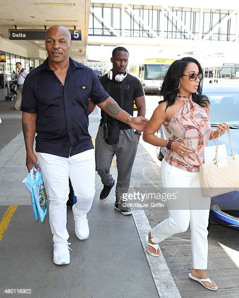 Mike Tyson and Lakiha Spicer is seen at LAX on July 09 2015 in Los Angeles California