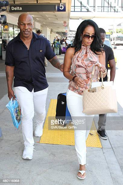Mike Tyson and Lakiha Spicer is seen at LAX on July 09, 2015 in Los Angeles, California.