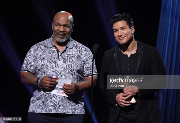 Mike Tyson and Mario Lopez present onstage during the 2019 iHeartRadio Podcast Awards Presented By Capital One at iHeartRadio Theater on January 18...