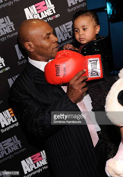 Mike Tyson and Milan Tyson attend Animal Planet's Taking On Tyson premiere Party at the Gansevoort Hotel Park Avenue on March 2 2011 in New York City