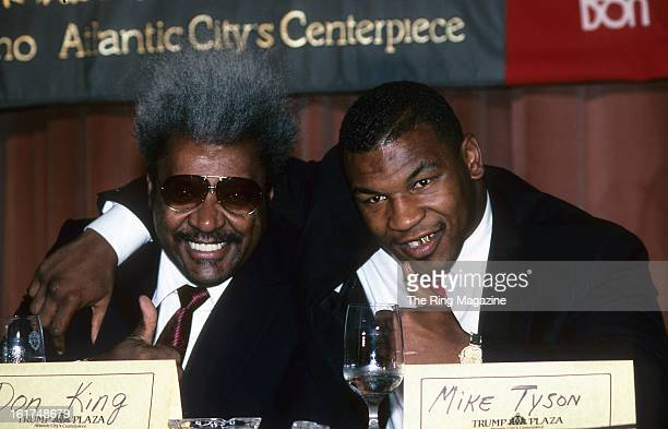 Mike Tyson and Promoter Don King pose during a press conference promoting his fight against Carl Williams in New York