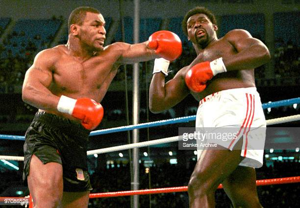 Mike Tyson and Tony Tubbs compete during the WBA/WBC/IBF Heavyweight Title Bout at Tokyo Dome on March 21 1988 in Tokyo Japan