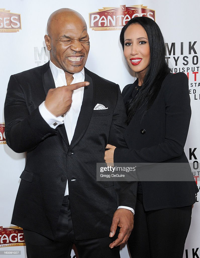 Mike Tyson and wife Kiki Tyson arrive at the Los Angeles opening night of 'Mike Tyson - Undisputed Truth' at the Pantages Theatre on March 8, 2013 in Hollywood, California.