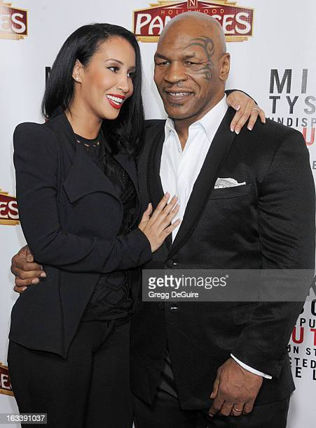 Mike Tyson and wife Kiki Tyson arrive at the Los Angeles opening night of Mike Tyson Undisputed Truth at the Pantages Theatre on March 8 2013 in...