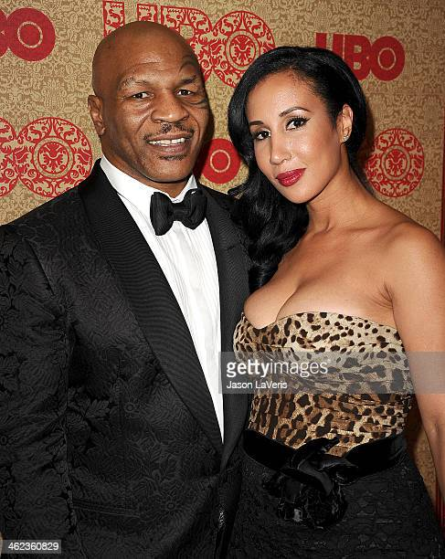 Mike Tyson and wife Lakiha 'Kiki' Spicer attend HBO's Golden Globe Awards after party at Circa 55 Restaurant on January 12 2014 in Los Angeles...