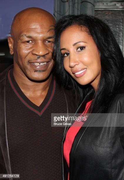 Mike Tyson and wife Lakiha Spicer Tyson pose backstage at the hit musical After Midnight on Broadway at The Brooks atkinson Theater on May 15 2014 in...