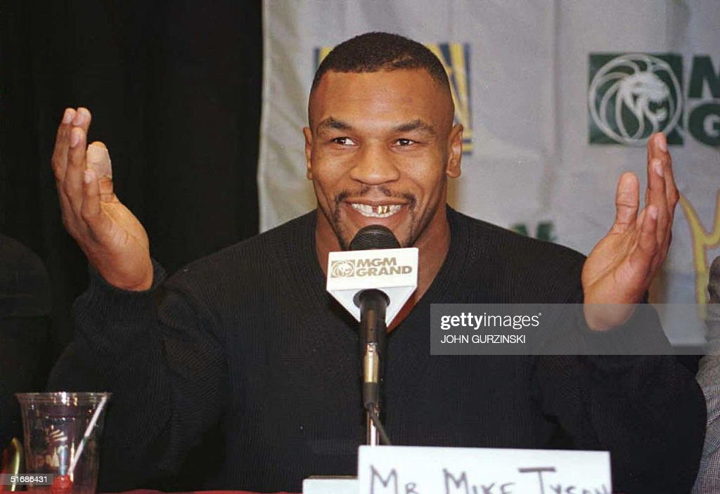 Mike tyson answers a question 06 october a press c pictures getty mike tyson answers a question 06 october a press conference in las vegas nevada m4hsunfo