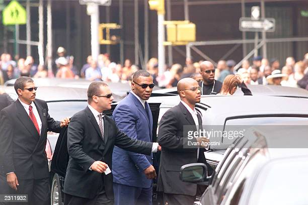 Mike Tyson arrives at RB singer Aaliyah's funeral at St Ignatius Loyola Roman Catholic Church in New York City 8/31/2001 Photo Evan...
