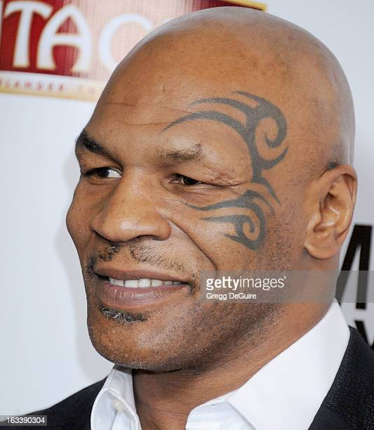 Mike Tyson arrives at the Los Angeles opening night of Mike Tyson Undisputed Truth at the Pantages Theatre on March 8 2013 in Hollywood California