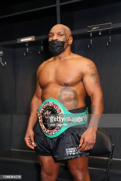 Mike Tyson celebrates after receiving a split draw against Roy Jones Jr. In the locker room during Mike Tyson vs Roy Jones Jr. Presented by Triller...