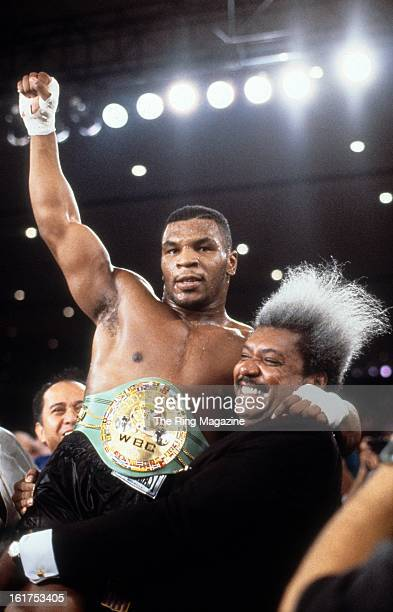 Mike Tyson celebrates with Don King after winning the fight against Trevor Berbick at Hilton Hotel in Las Vegas, Nevada. Mike Tyson won the WBC...