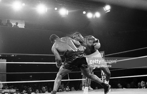 Mike Tyson connects a right hook to Jose Ribalta during a bout at Trump Plaza Hotel on August 17 1986 in Atlantic City New JerseyMike Tyson defeated...